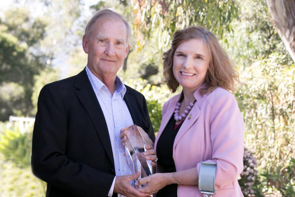 Kjell Rudestam and President Katrina Rogers with award