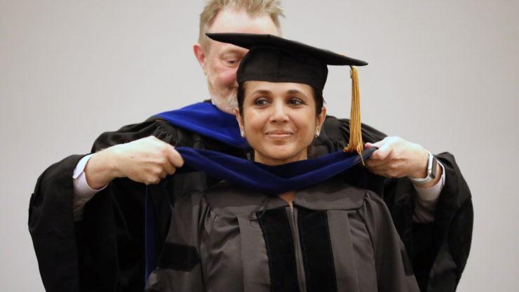 David Willis hoods a graduate